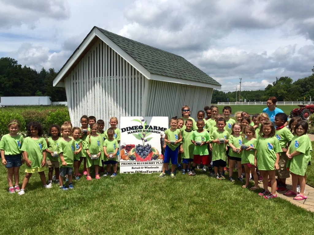 Kids love blueberry picking at DiMeo's Blueberry Farm in Hammonton, New Jersey